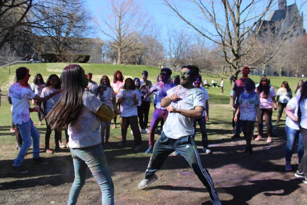 Students dancing during Holi